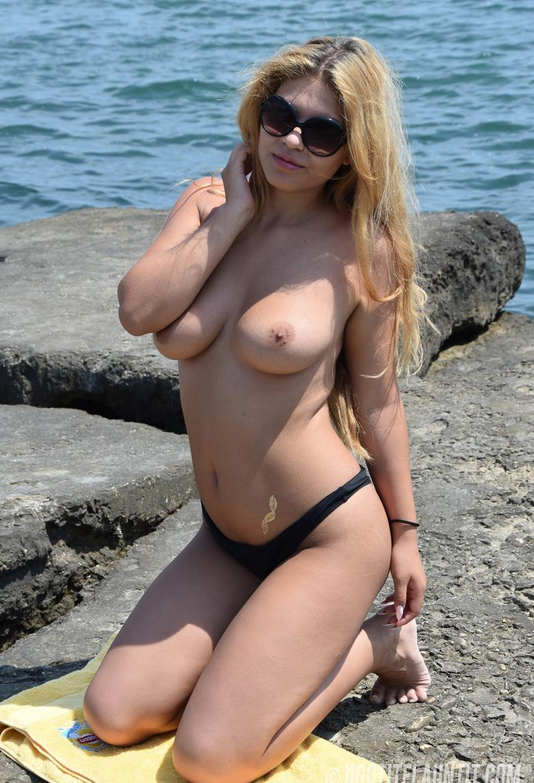 Roxana topless on the rocky shore in 15 photos from U Got It! Flaunt It! picture 15