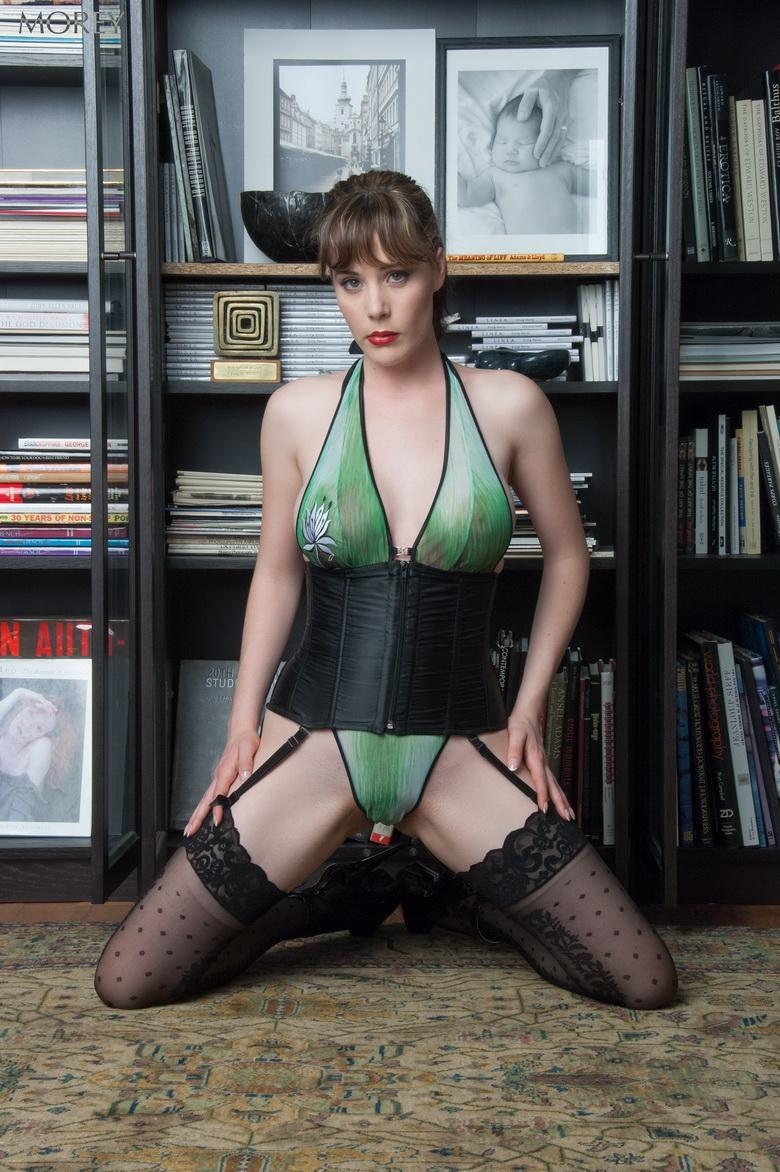 Heather in front of the famous bookcase in 15 photos from Morey Studio photo 3