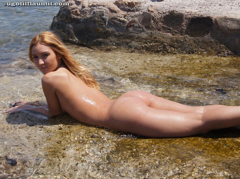 Honey gets naked on the shore in 15 photos from U Got It! Flaunt It! photo 15