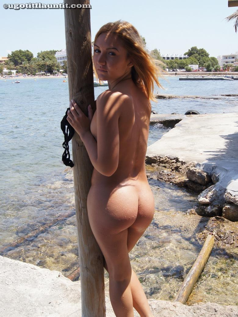 Honey gets naked on the shore in 15 photos from U Got It! Flaunt It! photo 10