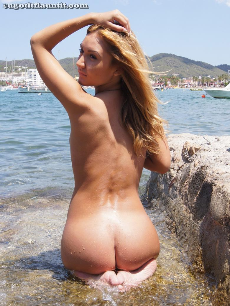 Honey gets naked on the shore in 15 photos from U Got It! Flaunt It! photo 13
