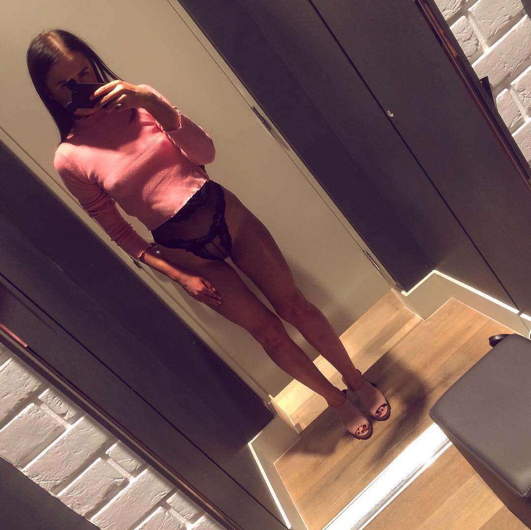 a beautiful skinny girl trying out different lingerie sets in the shopping mall picture 7