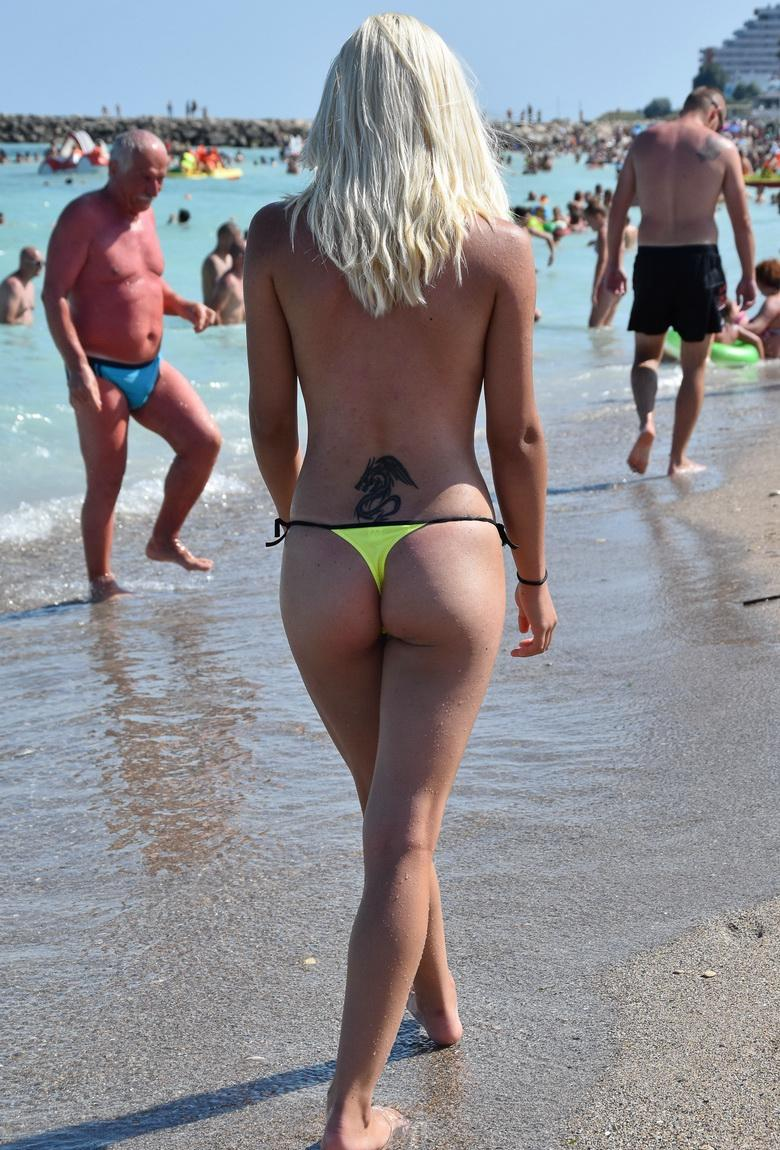 Blonde Betty topless on the beach in 15 photos from U Got It! Flaunt It! photo 15