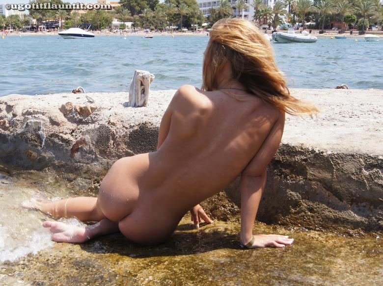 Honey gets naked on the shore in 15 photos from U Got It! Flaunt It! photo 12