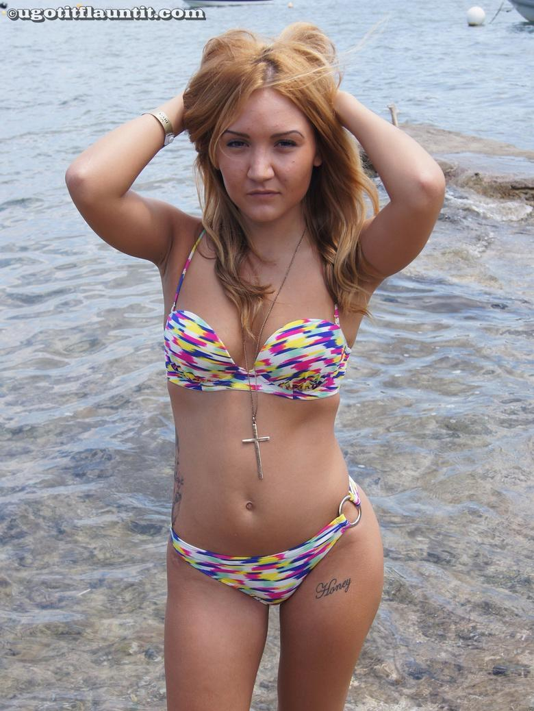 Honey gets naked on the shore in 15 photos from U Got It! Flaunt It! photo 3