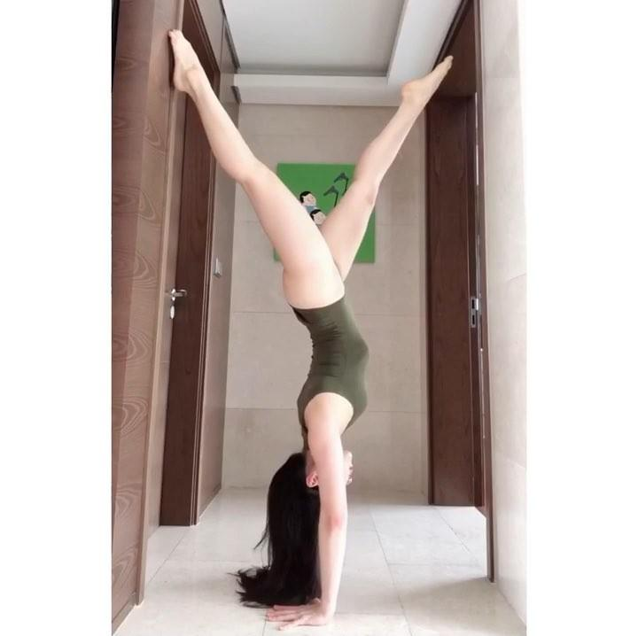 korean beauty in white body suit doing flexible yoga moves picture 10