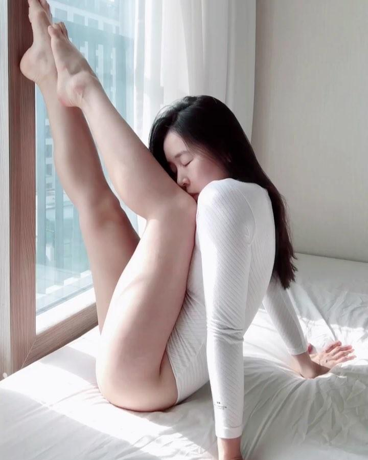 korean beauty in white body suit doing flexible yoga moves picture 7