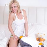 smiling blondie is cuddling her little penguin picture 13