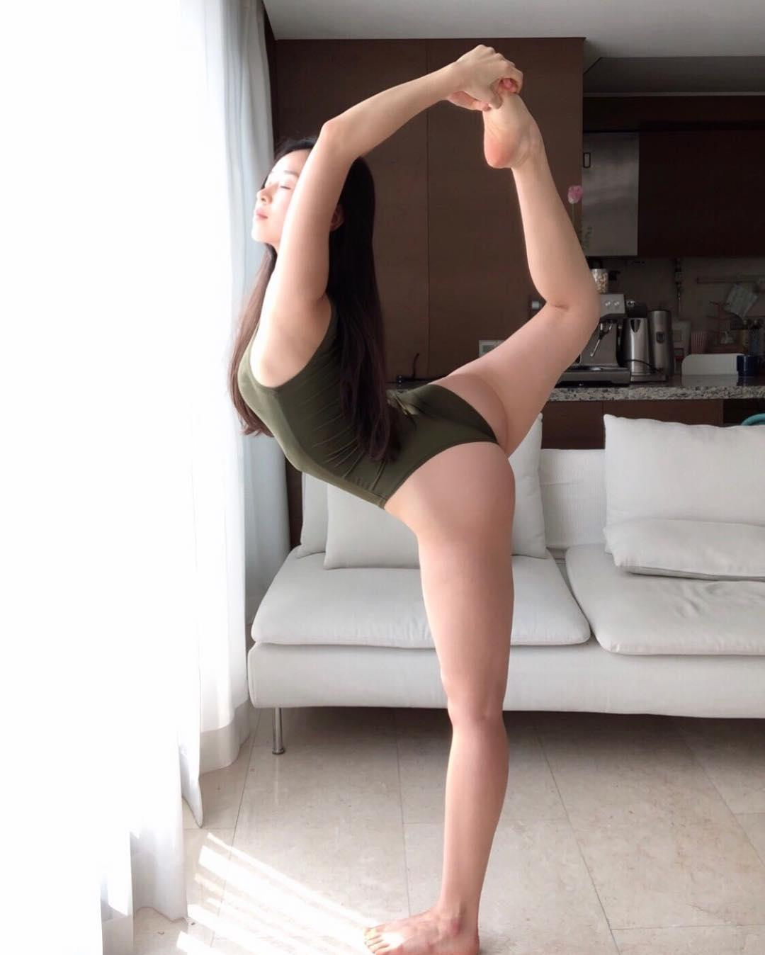 korean beauty in white body suit doing flexible yoga moves picture 8