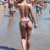 pretty girl with a tight little butt at the public beach picture 14