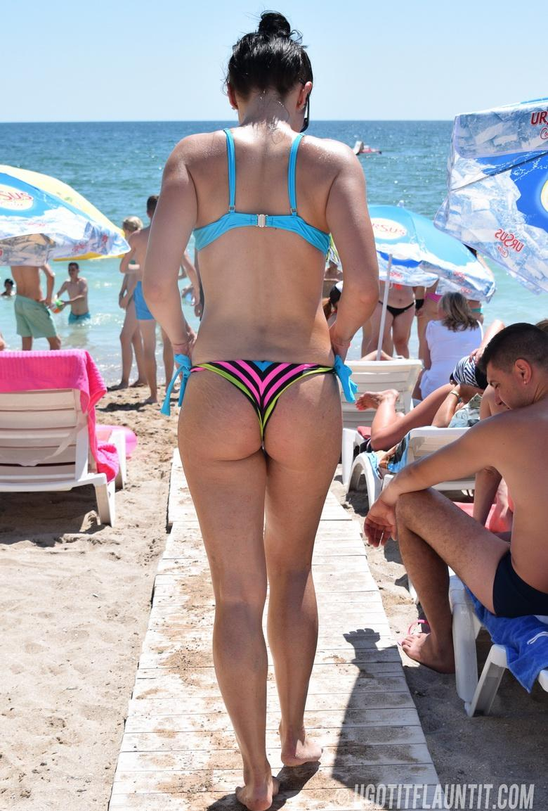 pretty girl with a tight little butt at the public beach picture 2