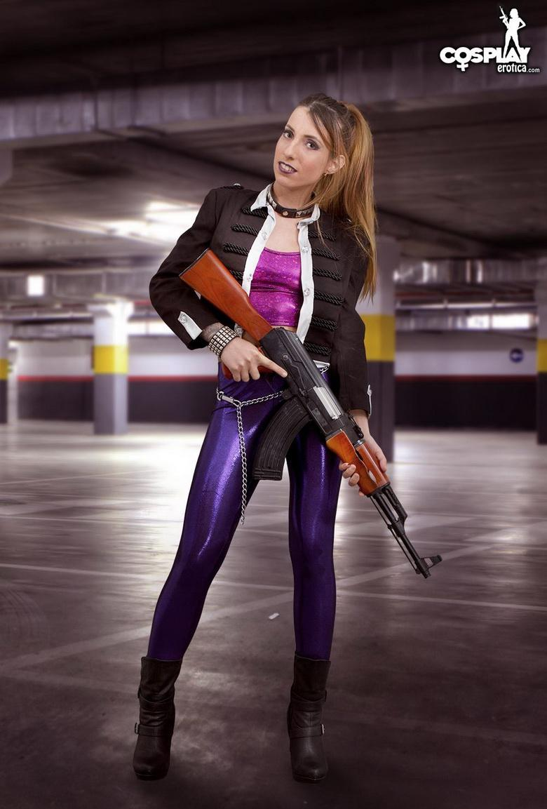 Pretty slim young woman is playing an agent cosplay in the underground garage picture 2