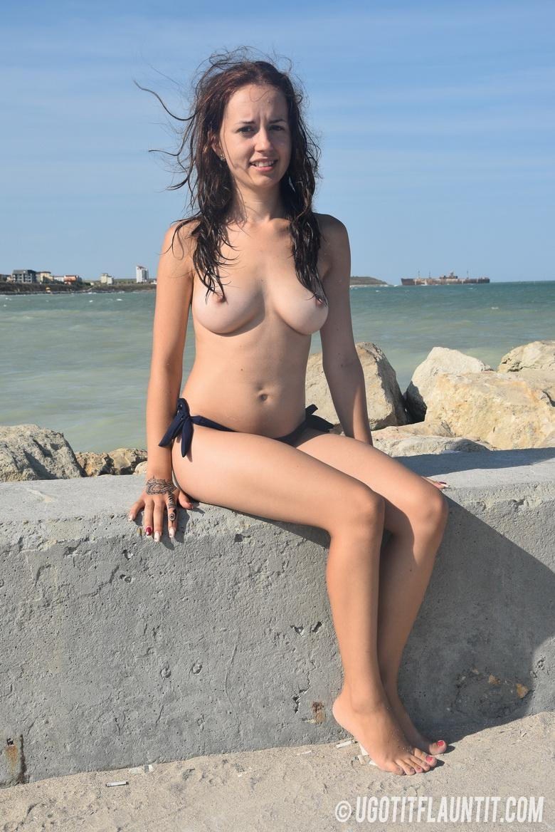 Diana topless on the rocky shore in 15 photos from U Got It! Flaunt It! photo 14