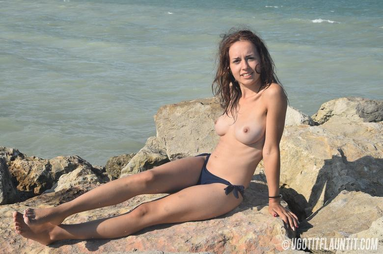 Diana topless on the rocky shore in 15 photos from U Got It! Flaunt It! photo 15