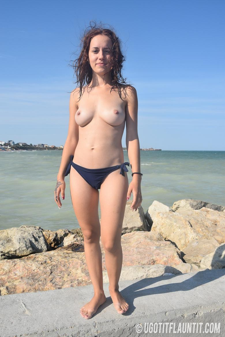 Diana topless on the rocky shore in 15 photos from U Got It! Flaunt It! photo 13