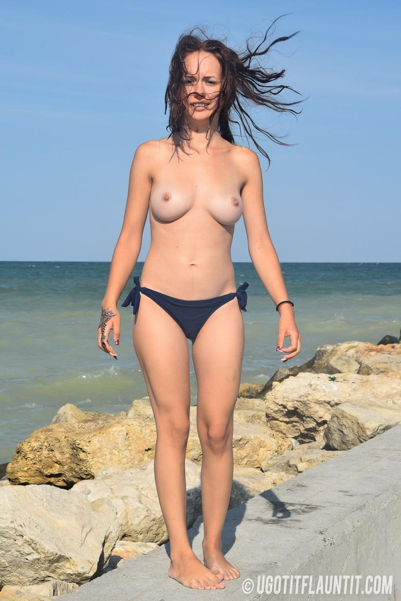Diana topless on the rocky shore in 15 photos from U Got It! Flaunt It! photo 8