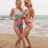 two stunning beach girls have the beach on their own to make teasing selfies picture 9