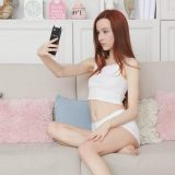 redhead teen girl doing secret selfies of her neat little cunt with new smartphone picture 14