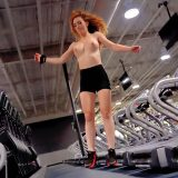 a skinny chick is testing out her new iphone while doing selfshots in the gym picture 7