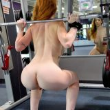 a skinny chick is testing out her new iphone while doing selfshots in the gym picture 15