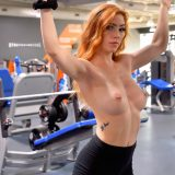 a skinny chick is testing out her new iphone while doing selfshots in the gym picture 3